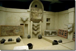 Fig replica of a Catal Hoyuk house, with everything public and domestic in one space:- a shrine, a hearth and ancestors under the bed