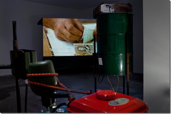 Installation shot of documentary projection in Nicholas Mangan 'Progress in Action'